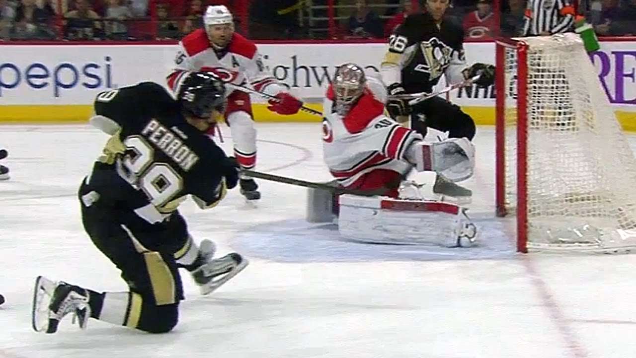 Canes goalie Cam Ward makes an incredible catching glove stop