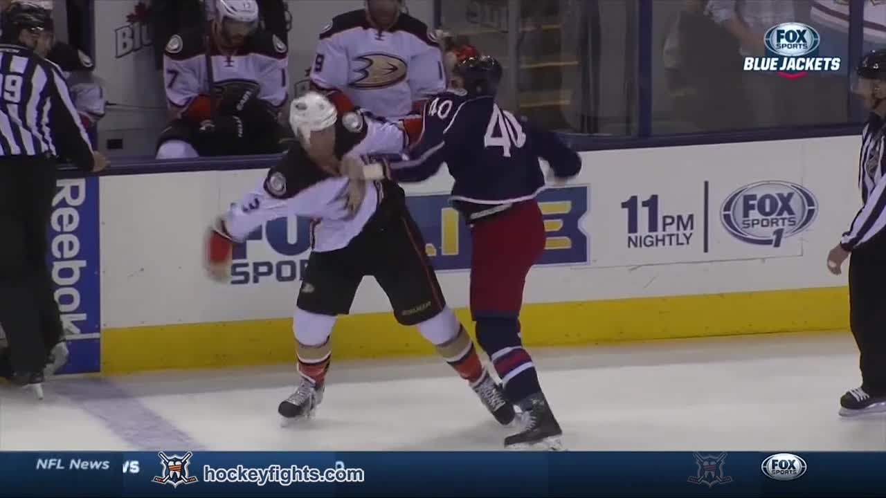 Jared Boll drops Clayton Stoner with an uppercut