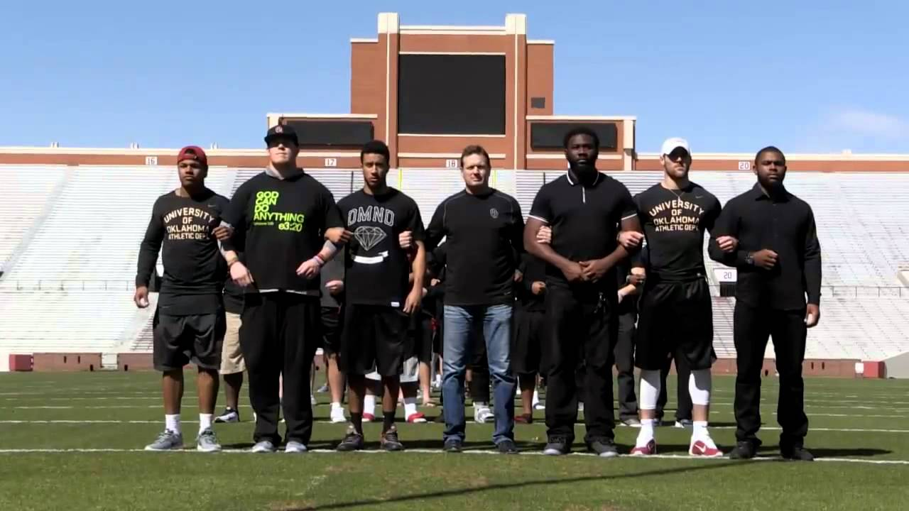Oklahoma football players demonstrate & Head coach Bob Stoops speaks