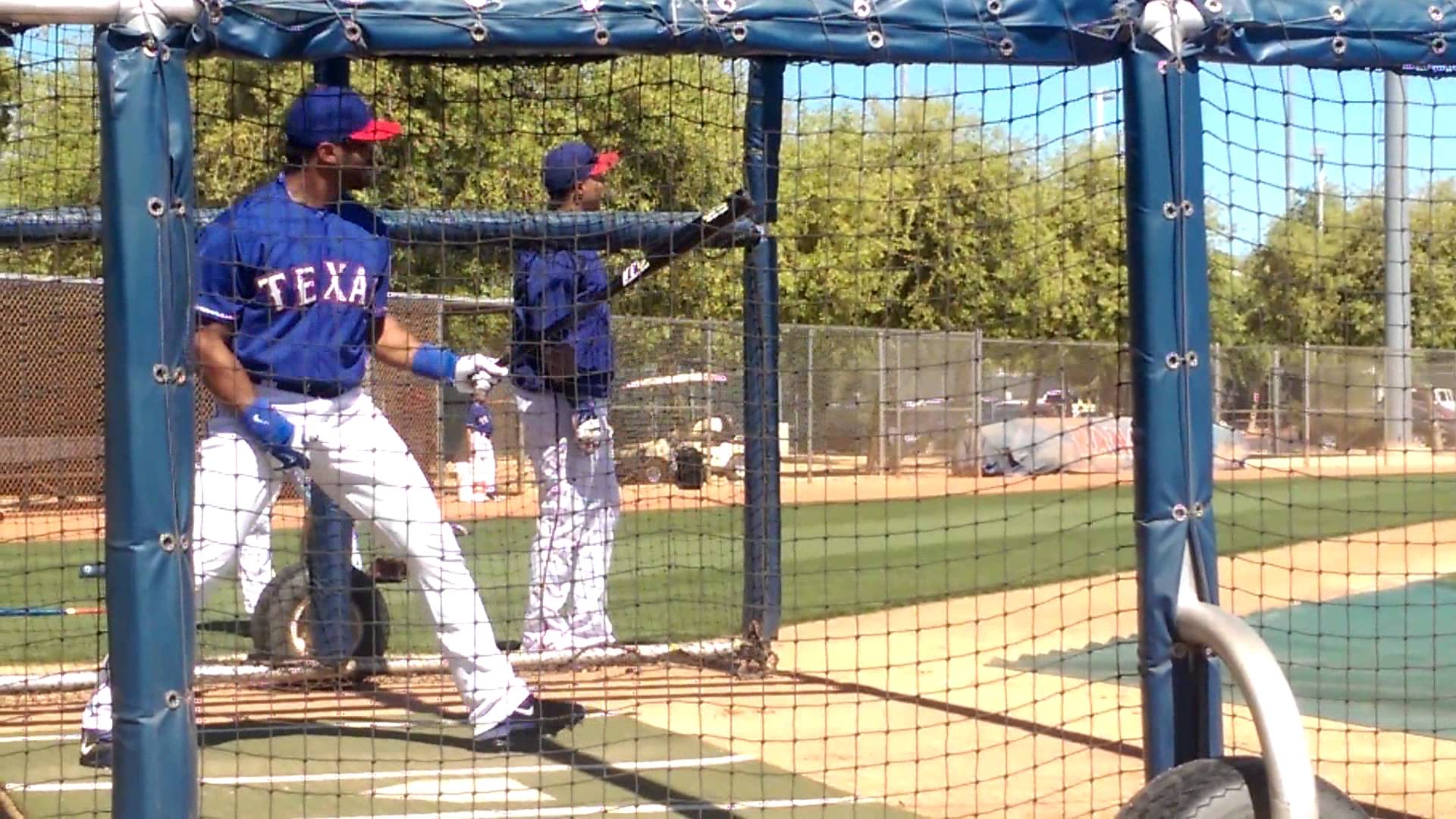 Seahawks QB Russell Wilson takes BP with the Texas Rangers