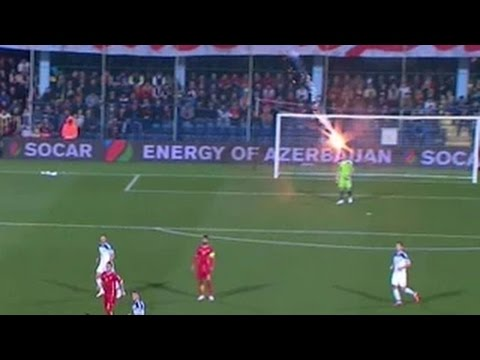 Wow: Russian goalkeeper Igor Akinfeev struck with a flare during match