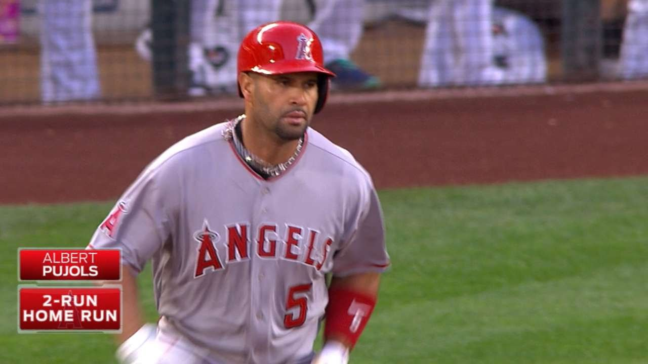 Albert Pujols deposits a shot into the upper tank at Safeco