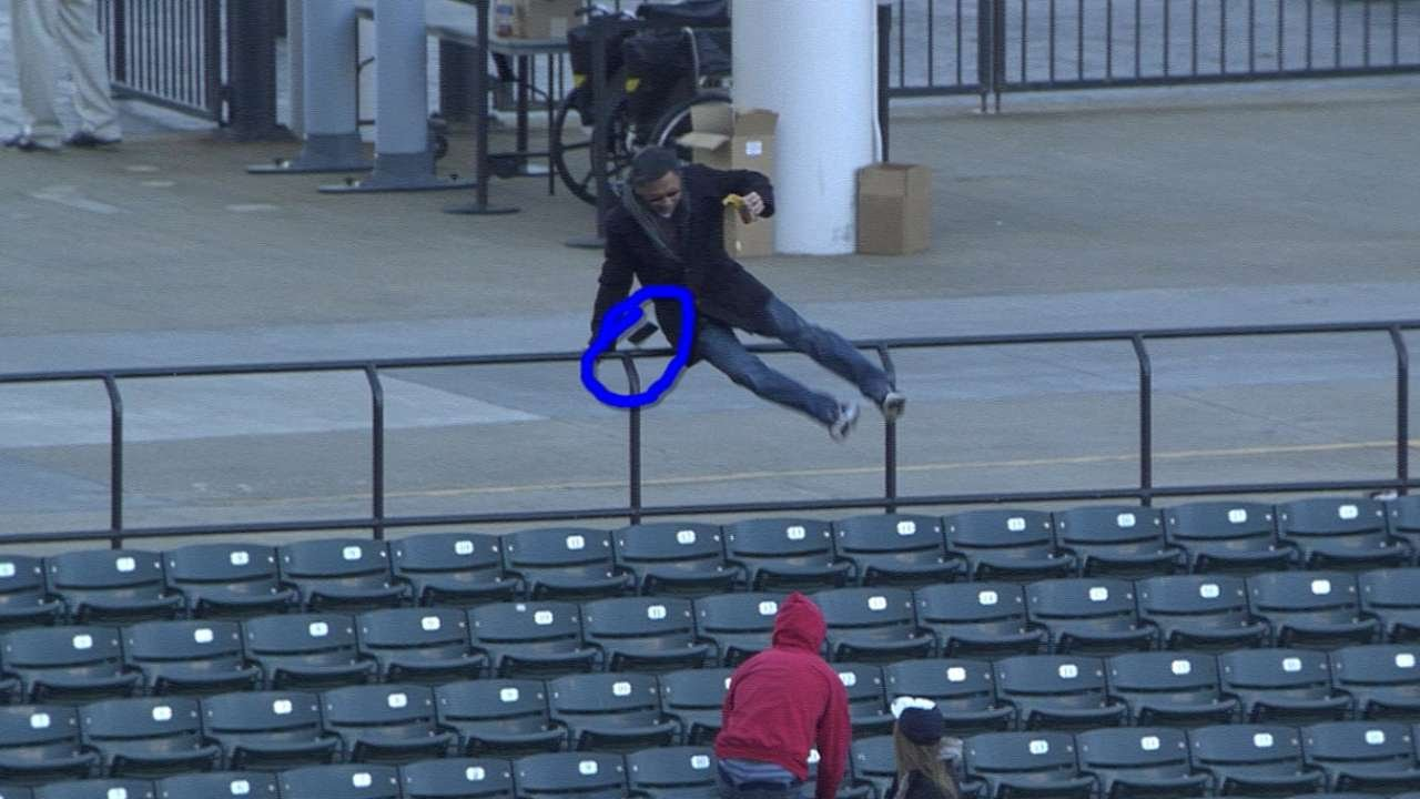 Determined fan ditches phone & beer for ball