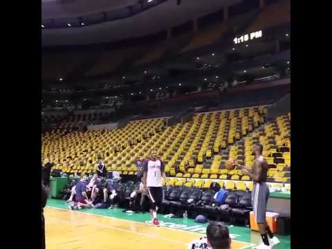 LeBron James drills a baseball throw in from one end of the court to the other