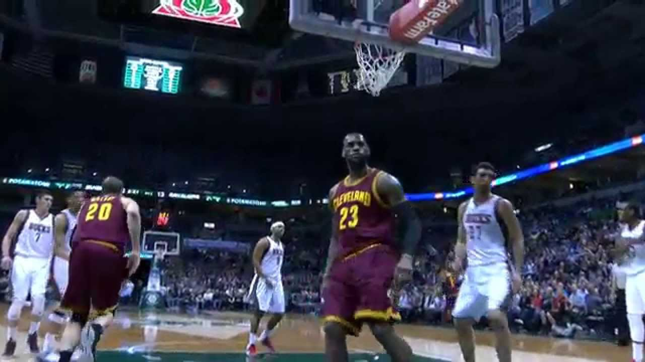 LeBron James throws down the slam from the no look Irving feed