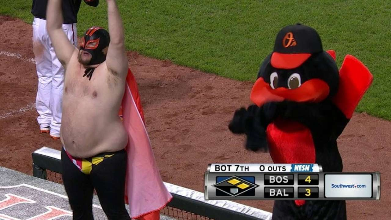Masked man dances with The Oriole Bird