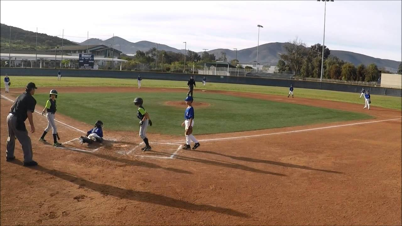 Youth baseball player impressively hurdles catcher