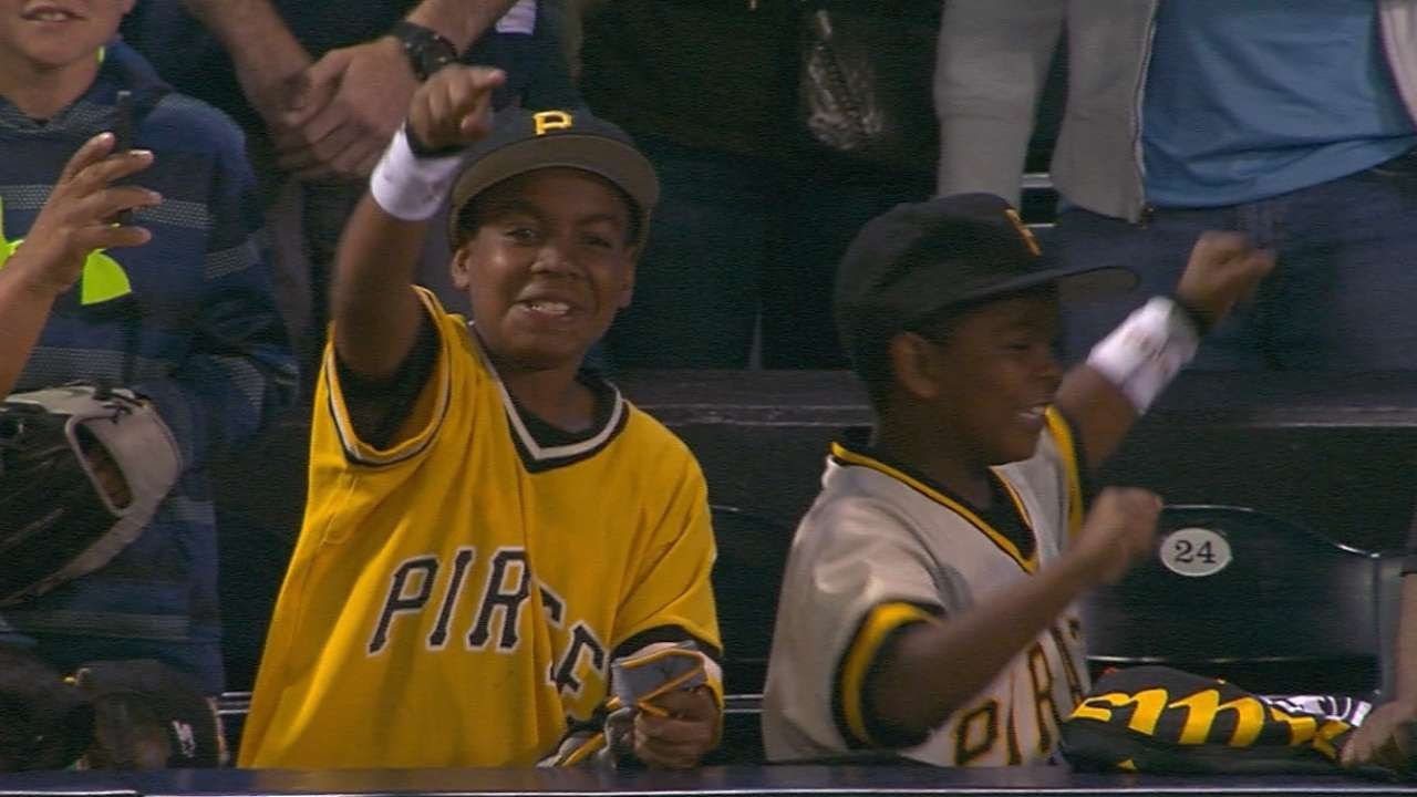 Andrew McCutchen gives his batting gloves to two young Pirates fans