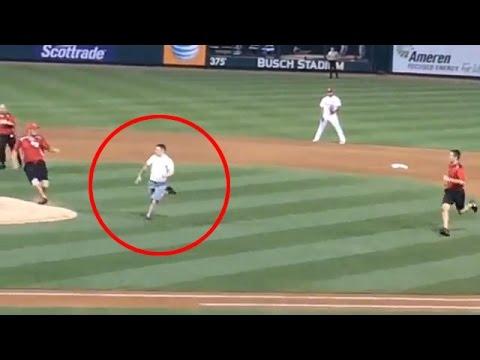 Baseball fan runs on the field & summersaults over home plate