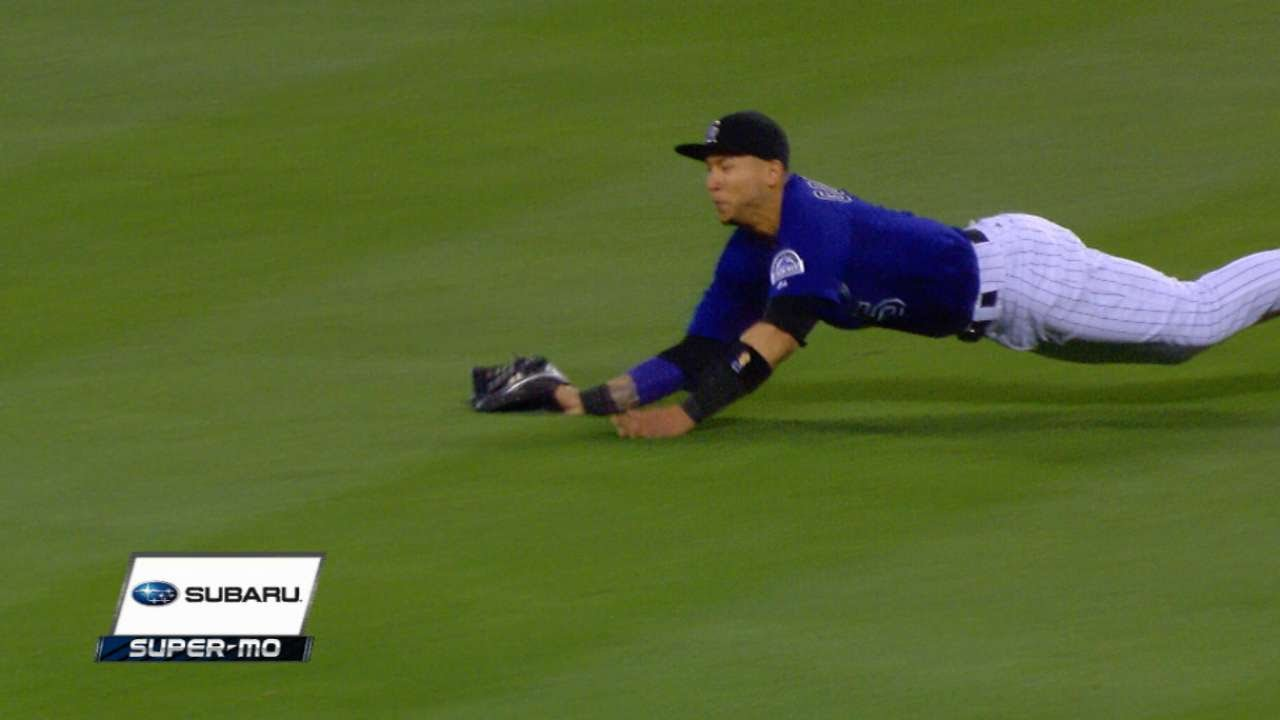 Carlos Gonzalez lays out to make an impressive grab