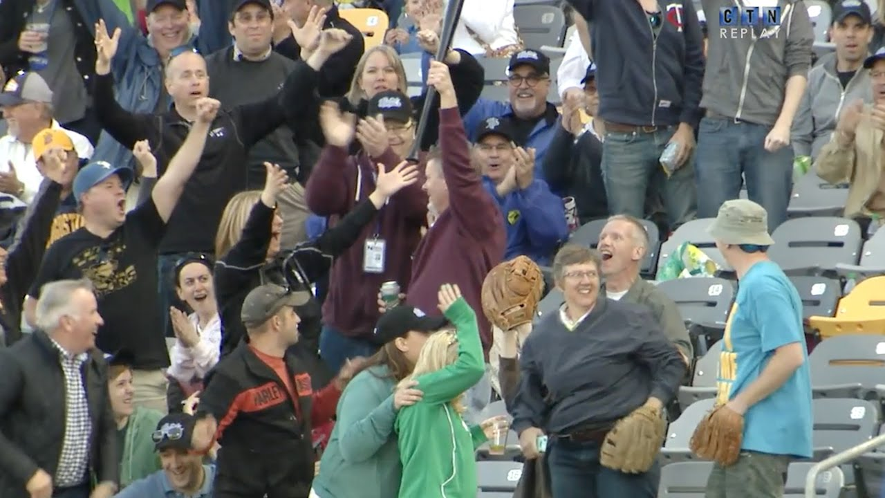 Fan makes impressive grab on bat flying into the stands