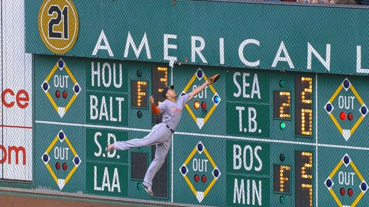 Giancarlo Stanton goes flying into the wall & makes spectacular catch
