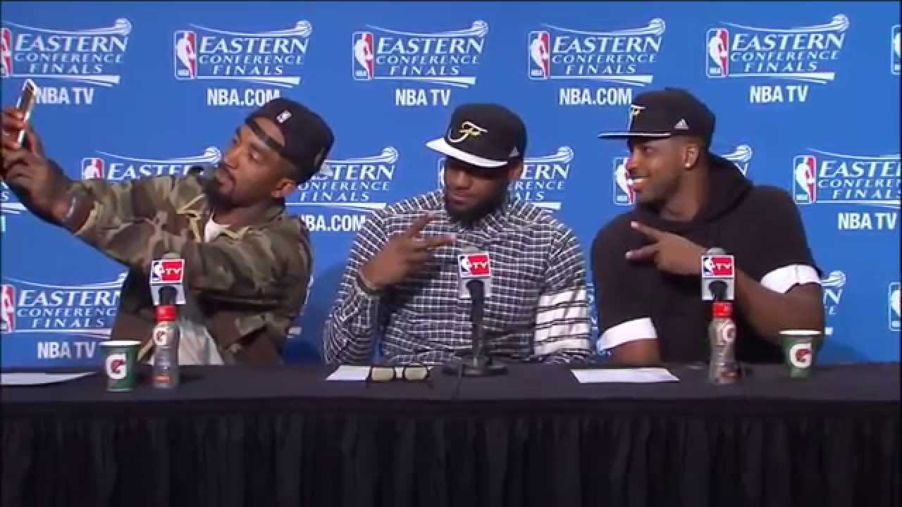 JR Smith takes a selfie during press conference with LeBron James