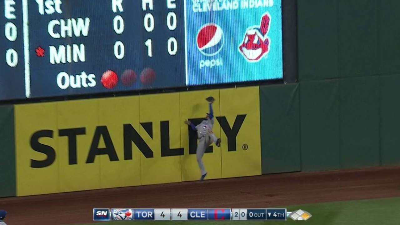Kevin Pillar makes a leaping catch at the wall