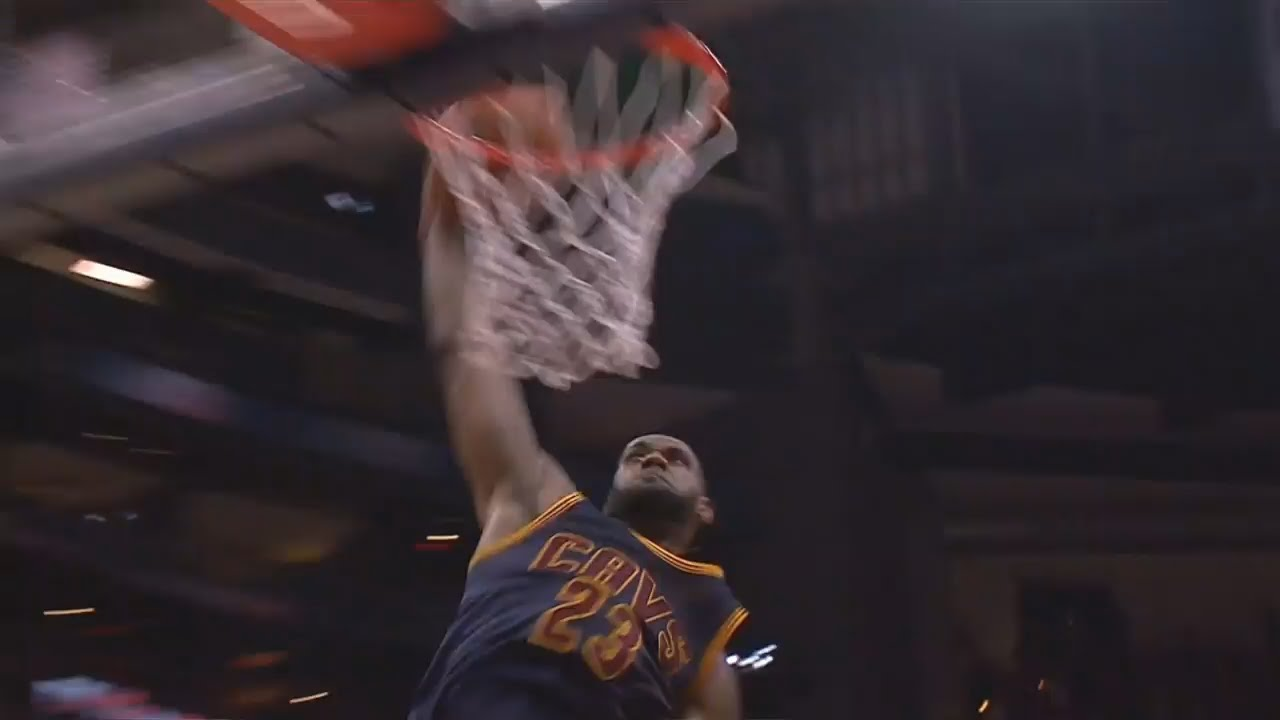 LeBron James soars for the massive finish & Hawks players duck out the way