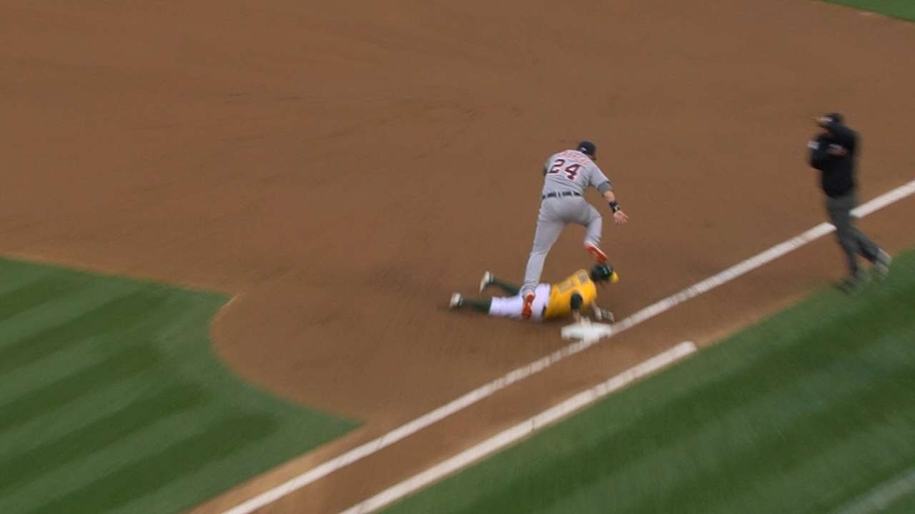 Miguel Cabrera pretends the ball has been thrown away on a pickoff