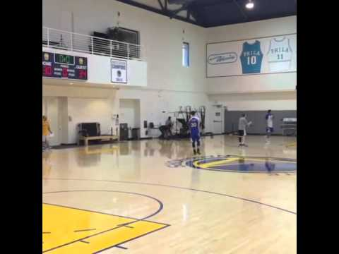 Steph Curry hits a no-look over the shoulder shot in practice