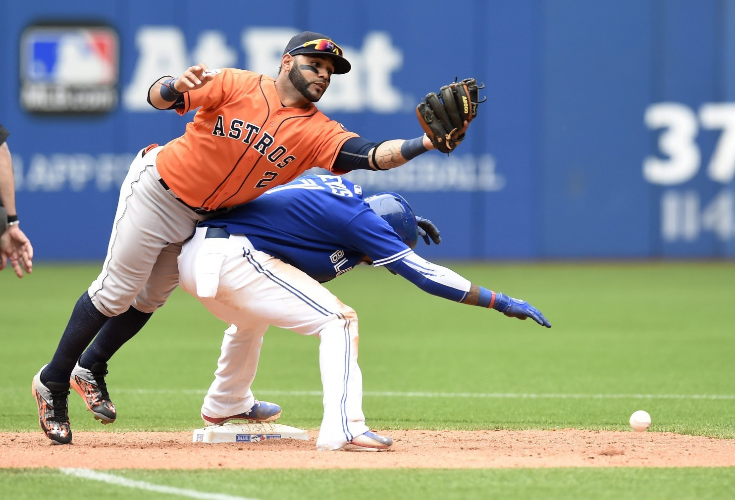 Jose Bautista singles on a pop up because of collision at 2nd base