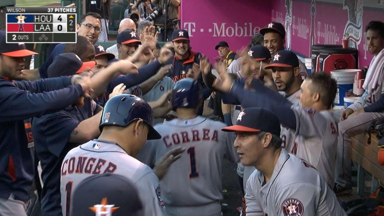 Carlos Correa tattoos mammoth three-run homer