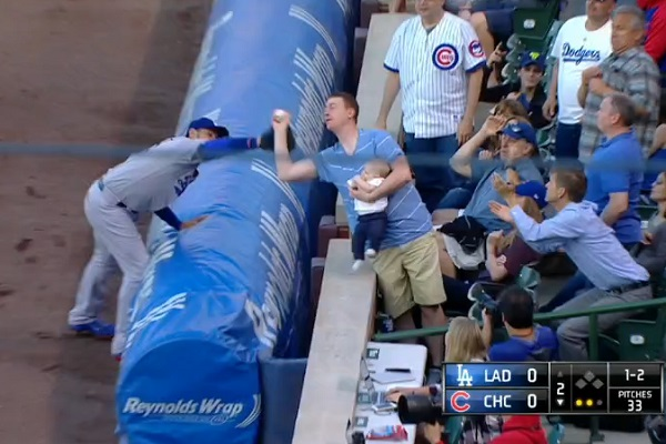 Fan robs Adrian Gonzalez with amazing catch of foul ball while holding baby