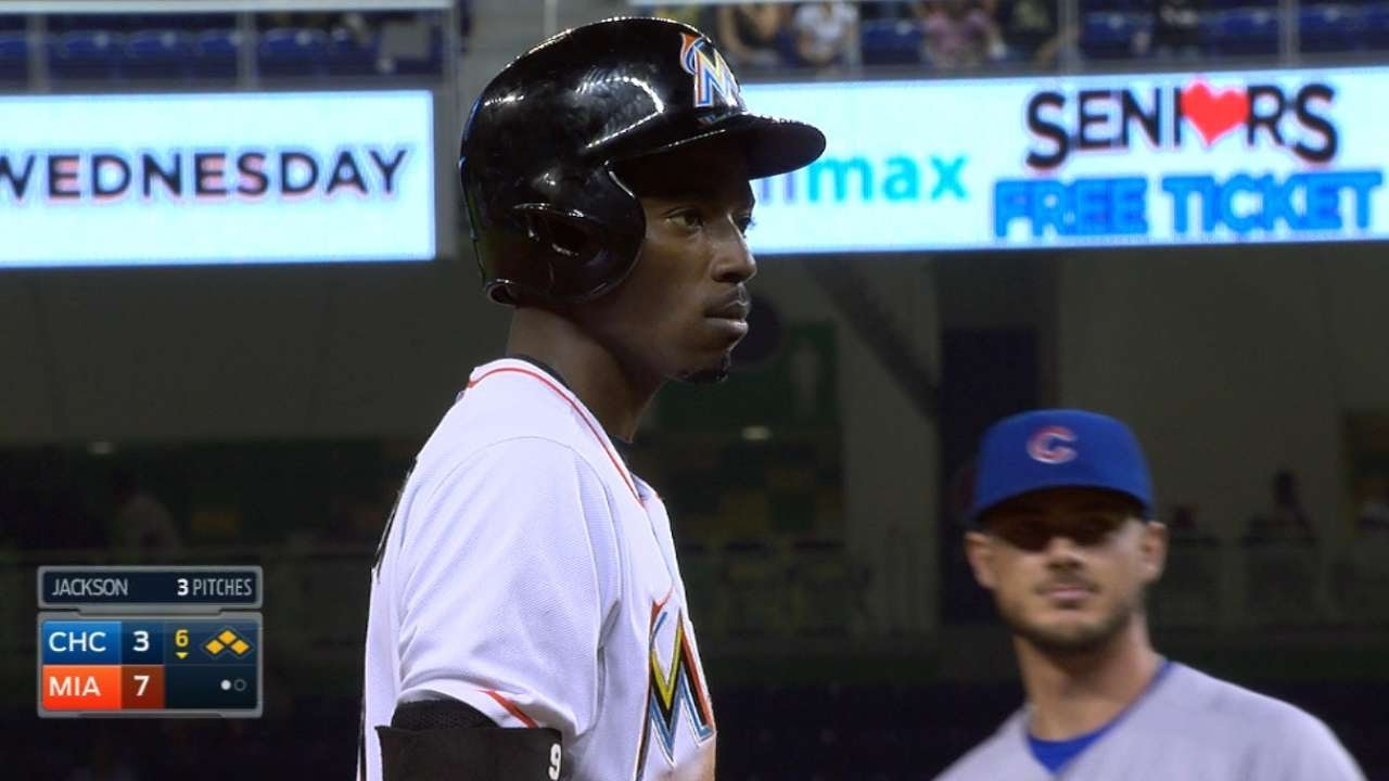 Dee Gordon slides safely into 2nd base but thinks he is out