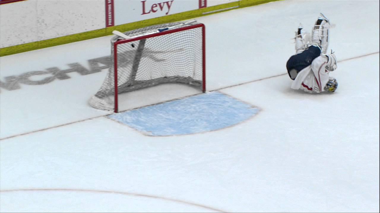 JJ Watt skates with the Wisconsin Badgers & drills home a slap shot