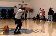 LeBron James bangs a half court jumper with ease during practice