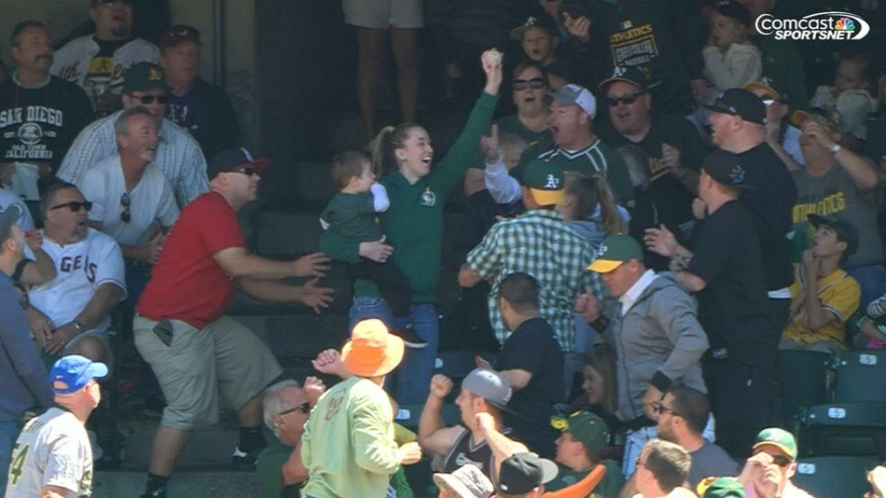 Oakland A's fan catches foul ball while holding child