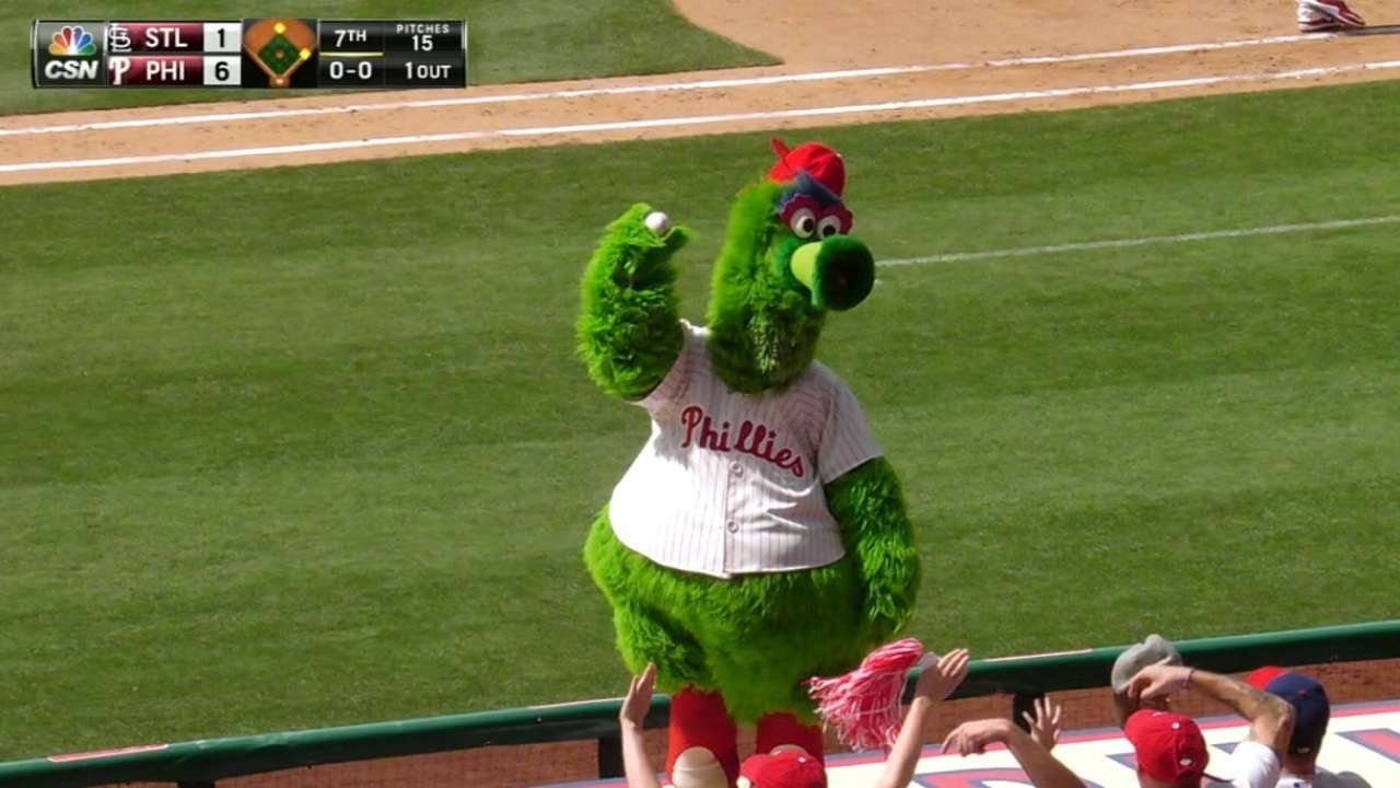 Phillie Phanatic dives on dugout to get foul ball