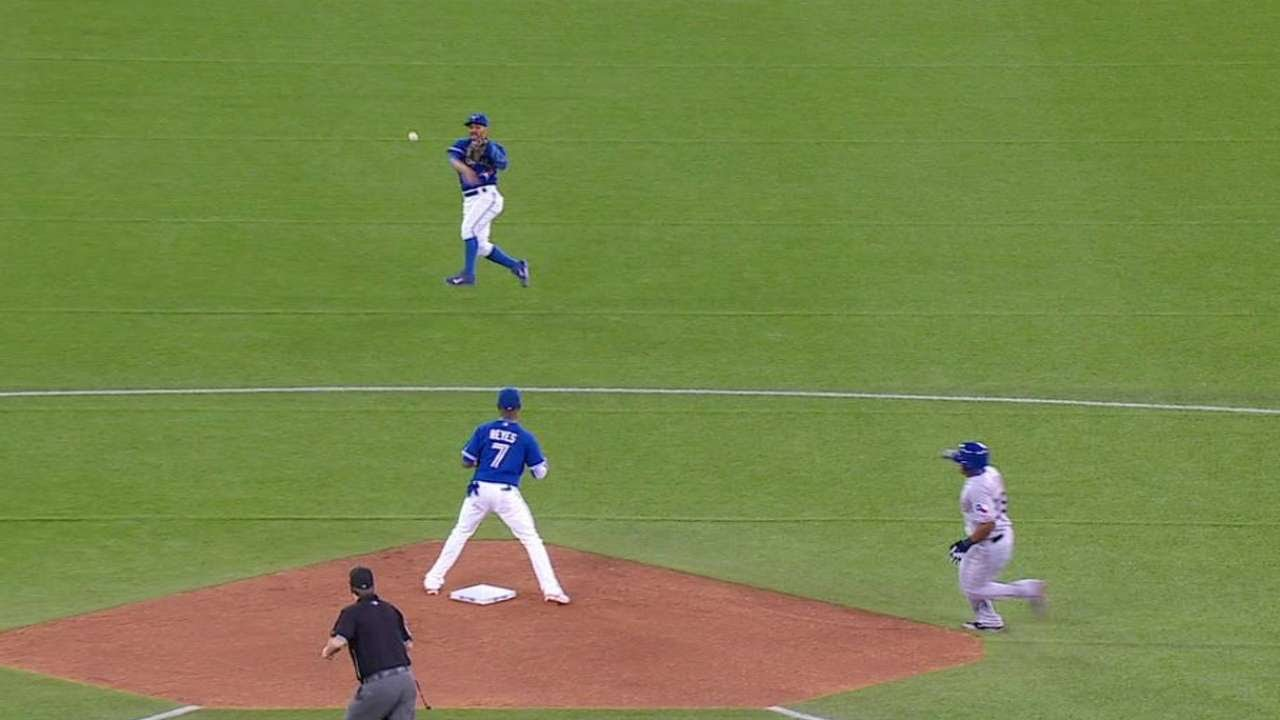 Rare Play: Devon Travis backs up Reyes after an overthrow