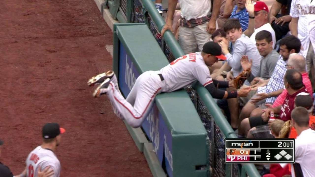 Ryan Flaherty smashes into the wall & reaches over railing to make catch