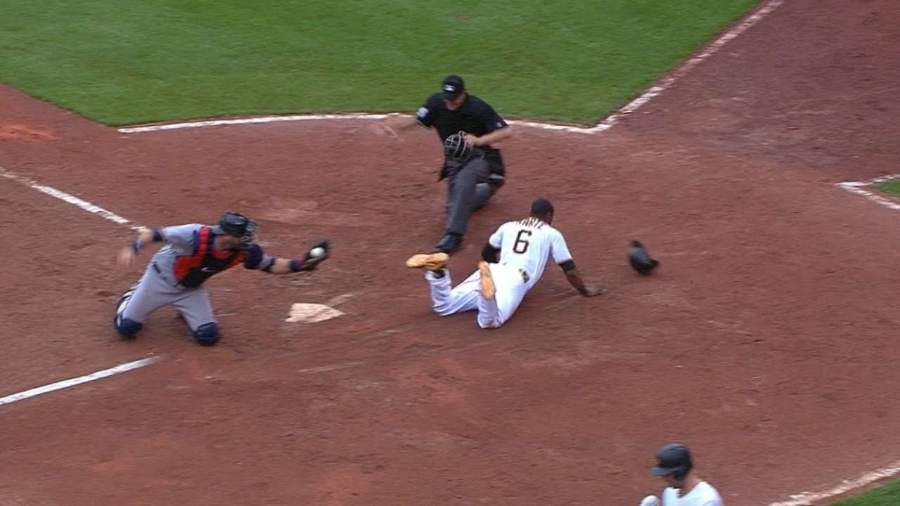 Starling Marte steals home after a pickoff attempt