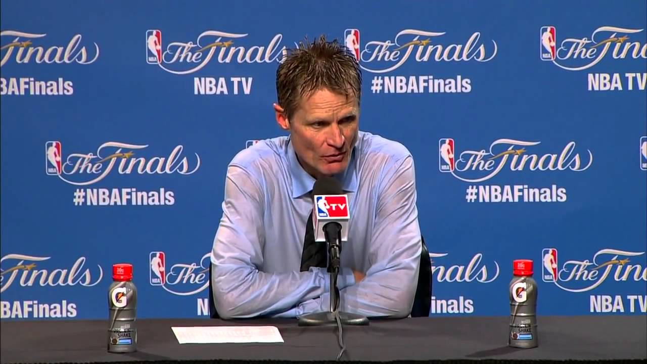 Steve Kerr covered in champagne for post game press conference