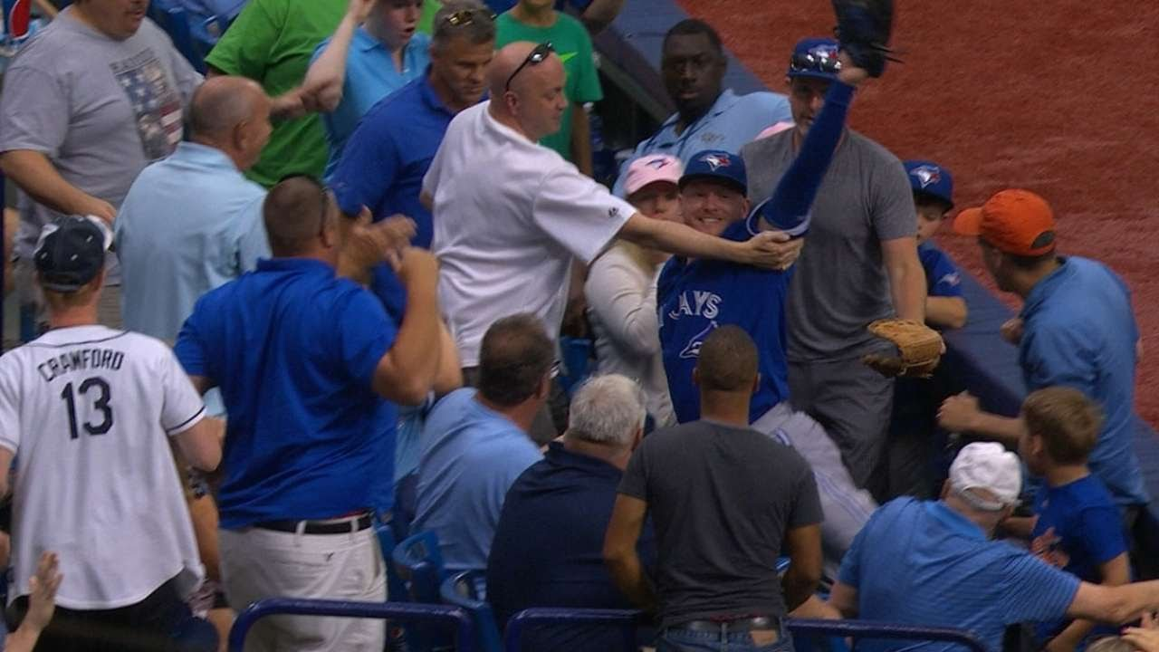Unbelievable: Josh Donaldson flies into the stands to make the catch