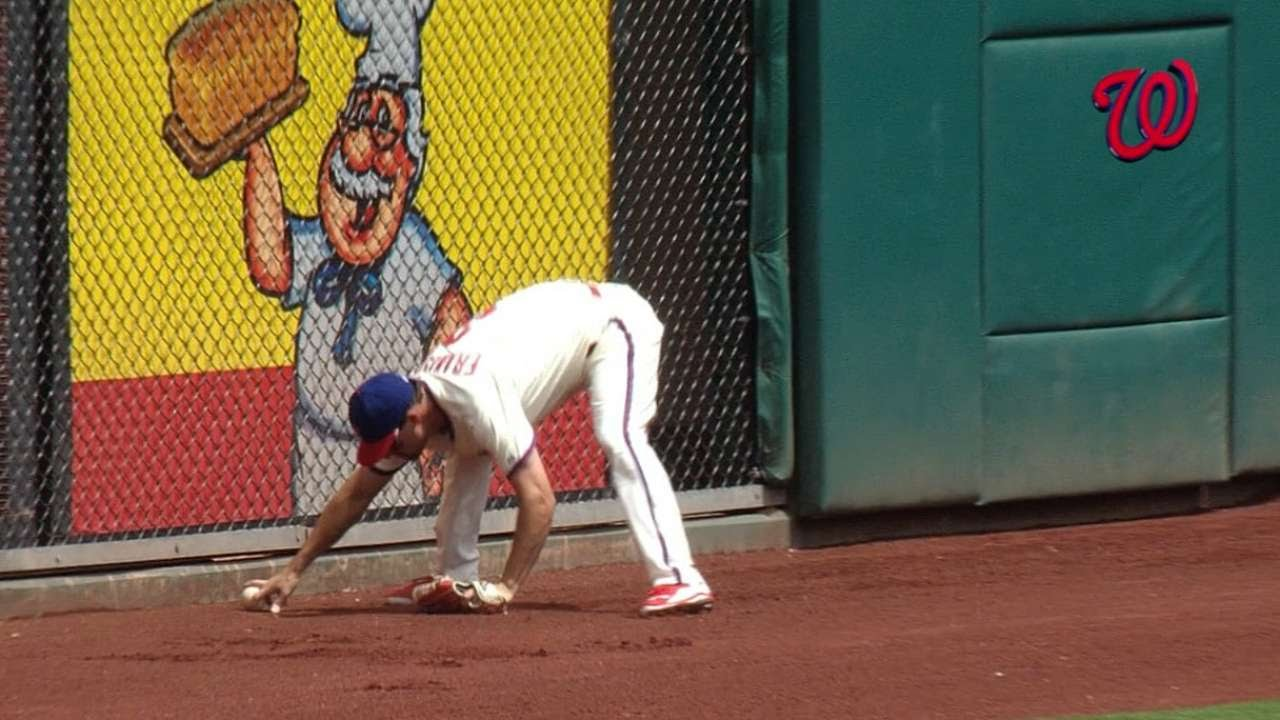 Wow: Jeff Francoeur whiffs his own throw from the outfield
