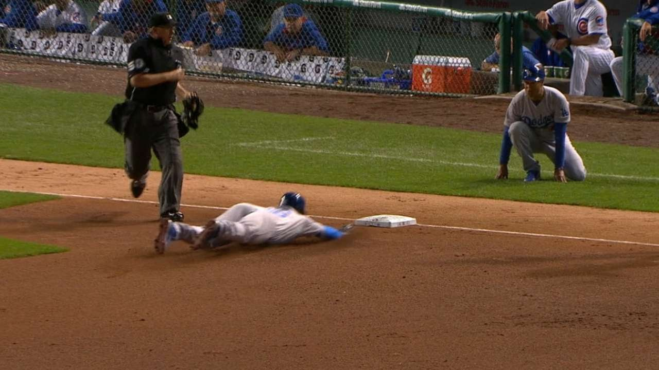 Yasiel Puig triples after Cubs lose sight of ball
