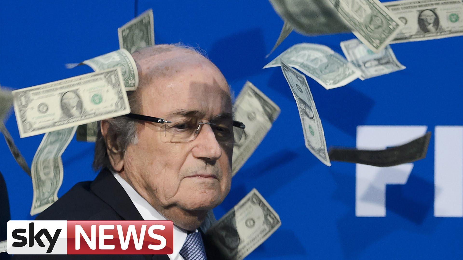 FIFA President Sepp Blatter has money thrown at him by Simon Brodkin