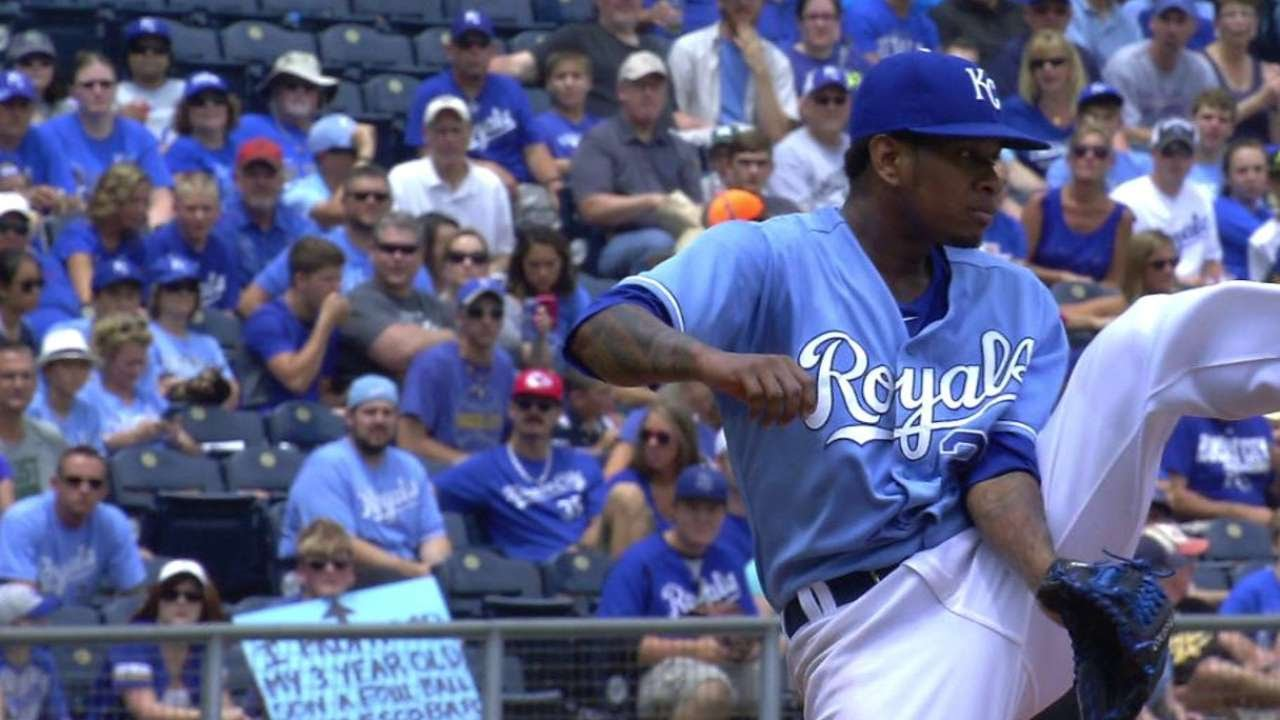 Yordano Ventura kicks a ball to second base for the out