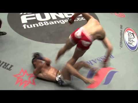 MMA fighter does a flip & kicks opponent in the groin on landing
