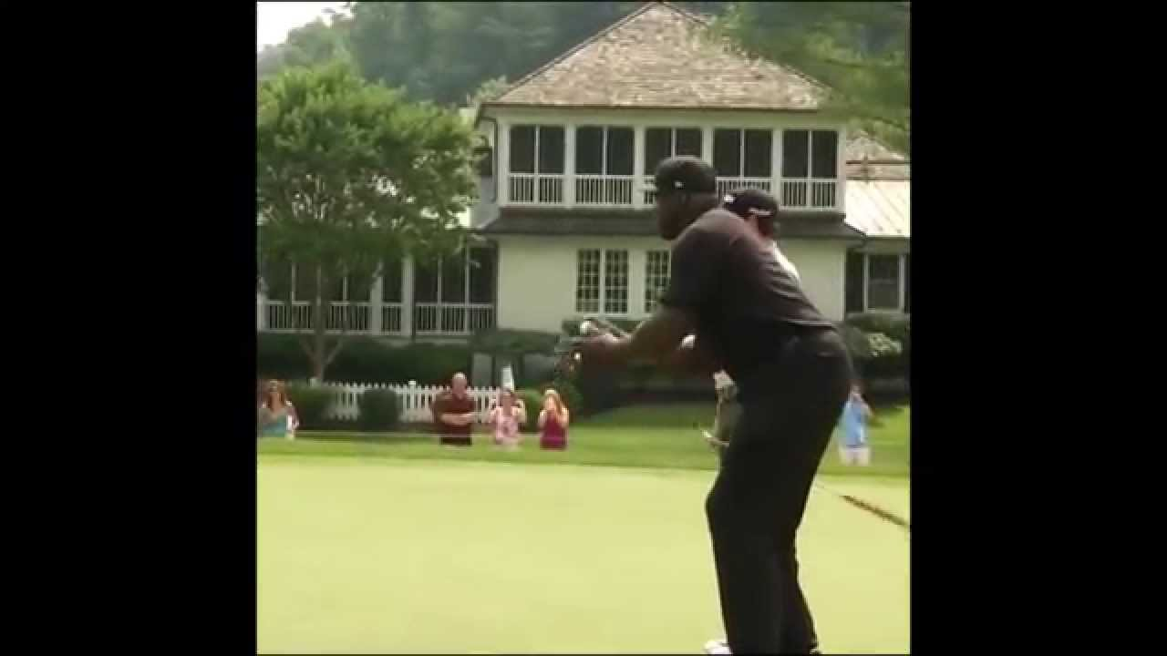 Shaquille O'Neal shoots a golf ball like a free throw into the hole