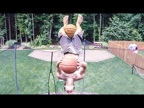 Wow: Double flip trick shot with two basketballs