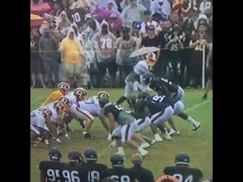 Disruptive Force: Vince Wilfork plows through Redskins offensive line