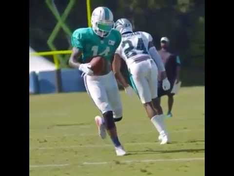 Dolphins WR Jarvis Landry goes behind the back on a juke with the football