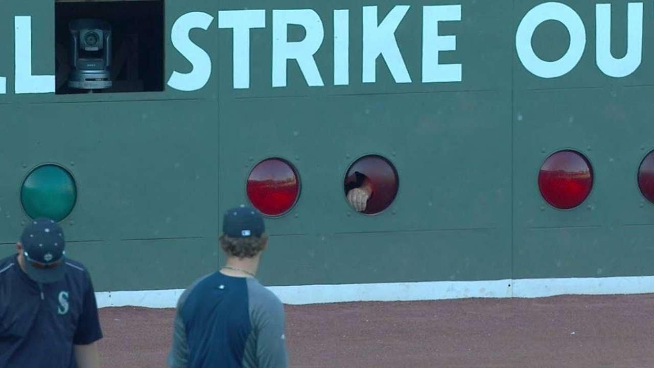 Red Sox break light on Green Monster in warmups