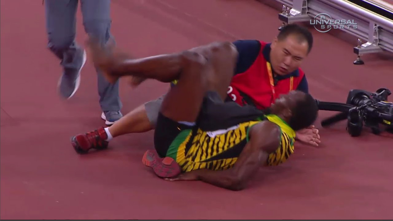Usain Bolt gets taken out by a camera man