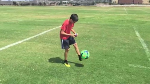 11 year old solves a rubik's cube while doing keep ups with a soccer ball