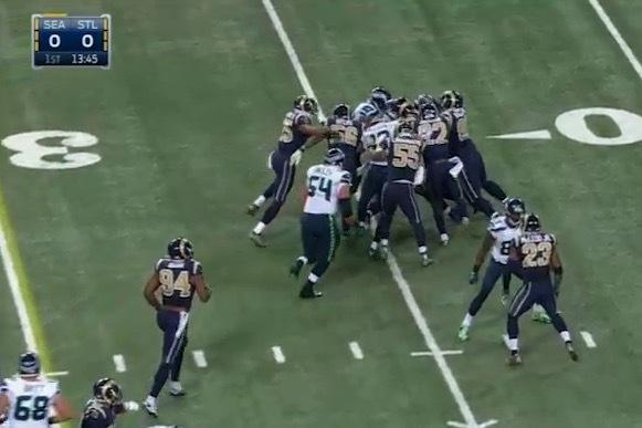 Beast Mode: Marshawn Lynch moves forward with half the Rams defense on him