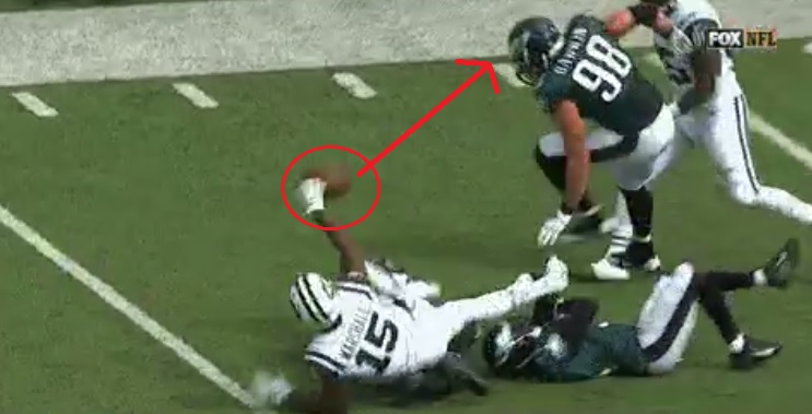 Bonehead Play: Brandon Marshall laterals after making a catch causing fumble