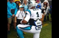 Cam Newton 'supermans' with a young fan before game