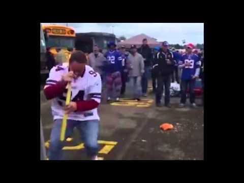 Damn: Buffalo Bills fan plays spinning drinking wiffle bat game & goes head first into bus